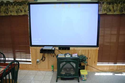eight foot theater screen at i love view a 2 bedroom cabin rental located in pigeon forge