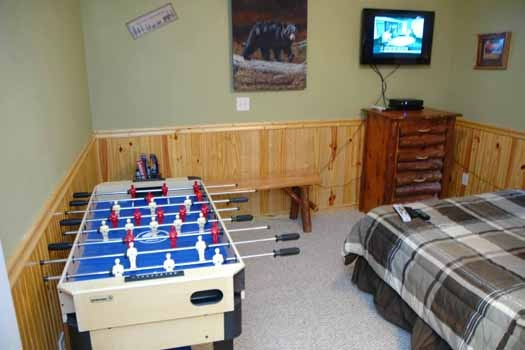 foosball table in a bedroom at i love view a 2 bedroom cabin rental located in pigeon forge