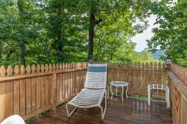 Chaise lounge on the deck at Just Us, a 1 bedroom cabin rental located in Pigeon Forge