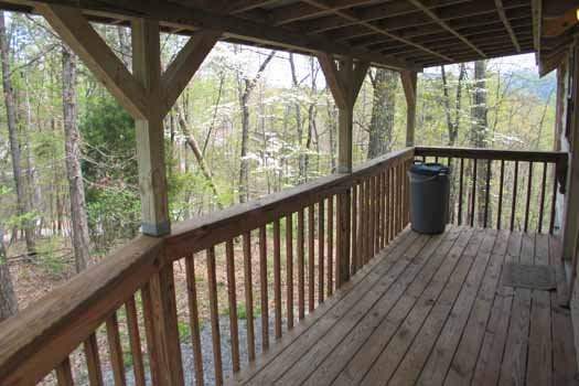 Front porch at Just Us, a 1 bedroom cabin rental located in Pigeon Forge