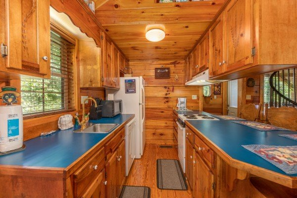 Galley kitchen at Just Us, a 1 bedroom cabin rental located in Pigeon Forge