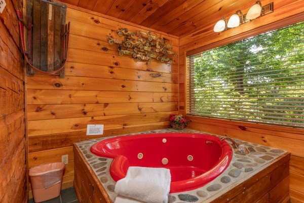Jacuzzi tub at Just Us, a 1 bedroom cabin rental located in Pigeon Forge