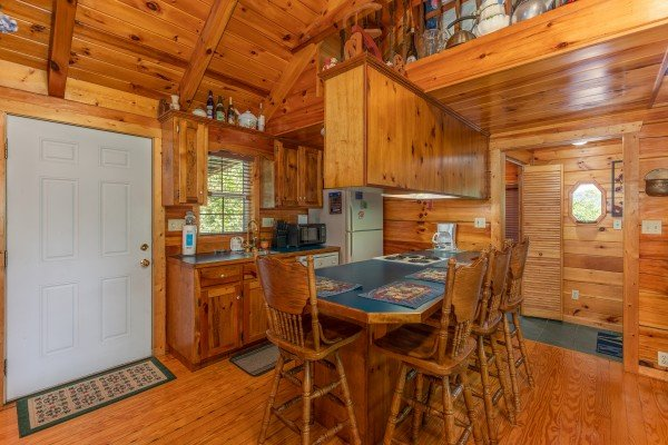 Kitchen and dining space at Just Us, a 1 bedroom cabin rental located in Pigeon Forge