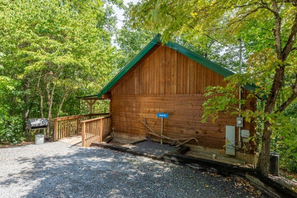 Parking and exterior of cabin at Just Us, a 1 bedroom cabin rental located in Pigeon Forge
