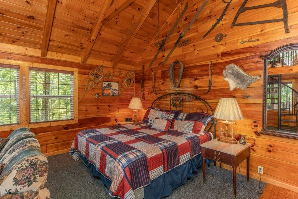 King sized bed at Just Us, a 1 bedroom cabin rental located in Pigeon Forge