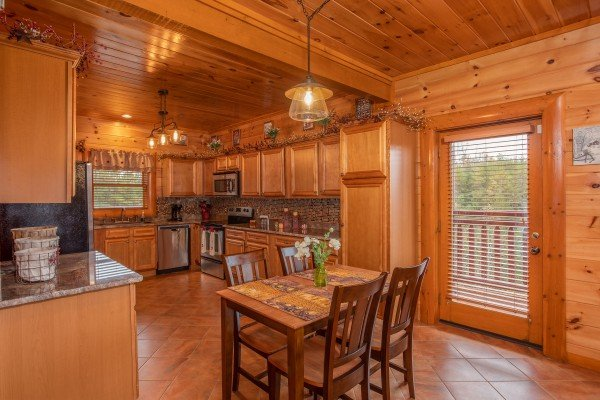 Second dining table with seating for four at Pool'n Around in the Smokies, a 4 bedroom cabin rental located in Sevierville