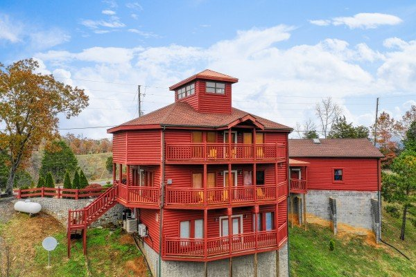 Exterior view of the back with three decks at Pool'n Around in the Smokies, a 4 bedroom cabin rental located in Sevierville