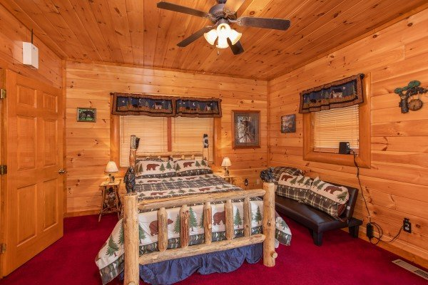 Full sized log bed and additional bedroom seating at Pool'n Around in the Smokies, a 4 bedroom cabin rental located in Sevierville