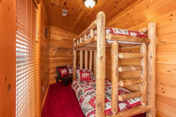 Twin sized log bunk beds at Pool'n Around in the Smokies, a 4 bedroom cabin rental located in Sevierville