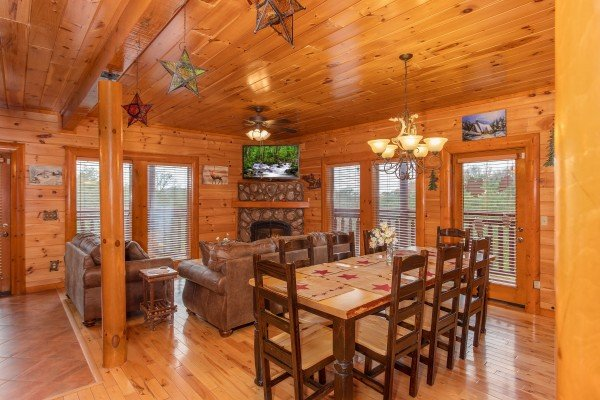 dining room with seating for eight at Pool'n Around in the Smokies, a 4 bedroom cabin rental located in Sevierville