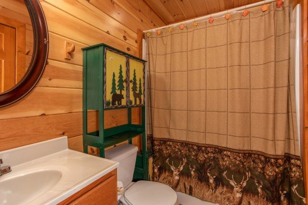 Bathroom with wildlife themed decor at Pool'n Around in the Smokies, a 4 bedroom cabin rental located in Sevierville