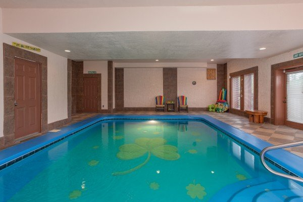Indoor pool with shamrock inlay at Pool'n Around in the Smokies, a 4 bedroom cabin rental located in Sevierville