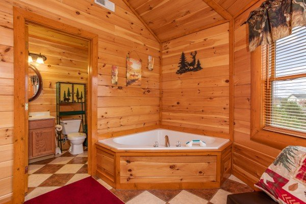 Jacuzzi in king bedroom at Pool'n Around in the Smokies, a 4 bedroom cabin rental located in Sevierville