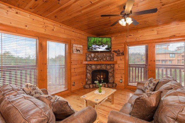 Living room with a couch and large chair at Pool'n Around in the Smokies, a 4 bedroom cabin rental located in Sevierville