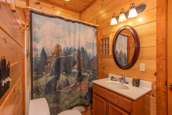 Bathroom with black bear decor at Pool'n Around in the Smokies, a 4 bedroom cabin rental located in Sevierville