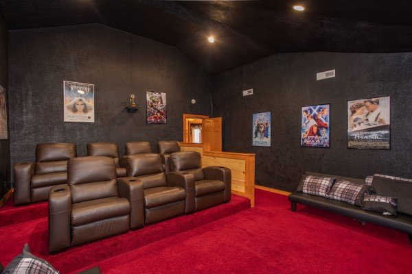Theater room with reclining seats for seven people at Pool'n Around in the Smokies, a 4 bedroom cabin rental located in Sevierville