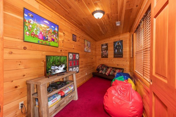 room with bean bag chairs and gaming systems at amazing sunset serenity a 4 bedroom cabin rental located in sevierville