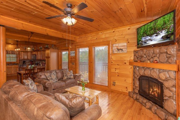 River stone fireplace with flat screen television at amazing sunset serenity a 4 bedroom cabin rental located in sevierville
