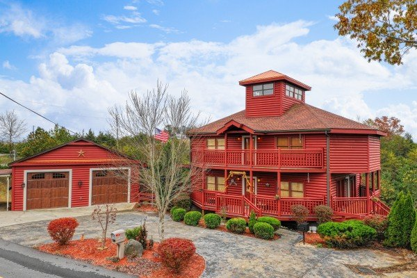 Front exterior and garage with parking at Pool'n Around in the Smokies, a 4 bedroom cabin rental located in Sevierville