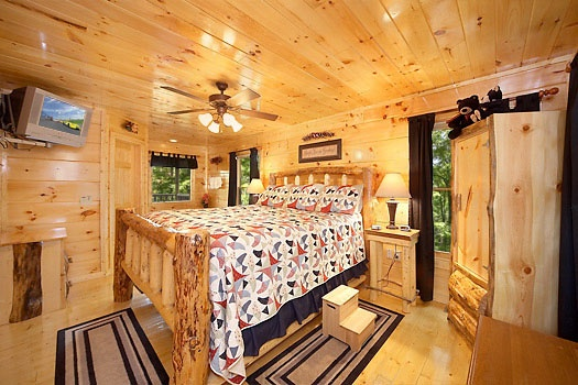 King sized log bed at Honey Bear Haven, a 1 bedroom cabin rental located in Pigeon Forge