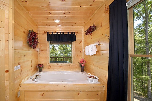 Jacuzzi tub in the bedroom at Honey Bear Haven, a 1 bedroom cabin rental located in Pigeon Forge