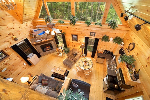 View of the living room from the lofted game room at Honey Bear Haven, a 1 bedroom cabin rental located in Pigeon Forge