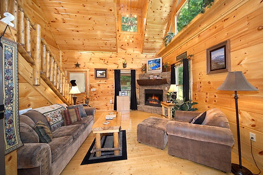 Living room with stone fireplace at Honey Bear Haven, a 1 bedroom cabin rental located in Pigeon Forge