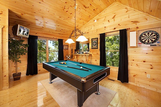 Lofted game room with pool table and dart board at Honey Bear Haven, a 1 bedroom cabin rental located in Pigeon Forge
