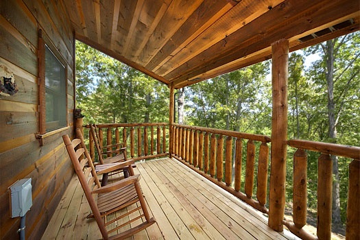 Rockers on the covered deck at Honey Bear Haven, a 1 bedroom cabin rental located in Pigeon Forge