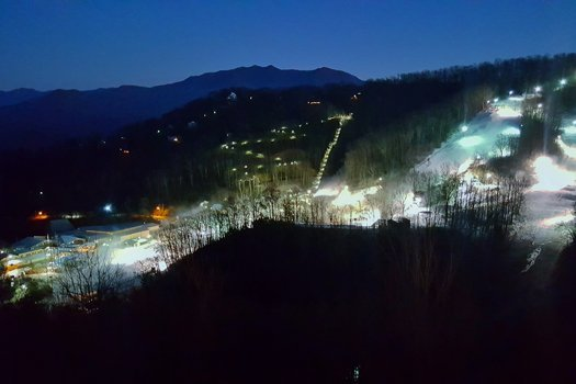 Ober Gatlinburg ski area at night is near Pinot Splash, a 4 bedroom cabin rental located in Gatlinburg