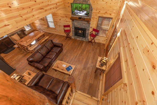 Looking down into the living room at Pinot Splash, a 4 bedroom cabin rental located in Gatlinburg