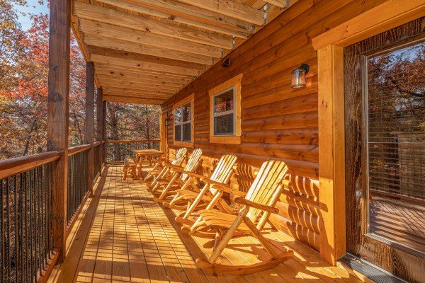 Rocking chairs on a covered porch at Pinot Splash, a 4 bedroom cabin rental located in Gatlinburg