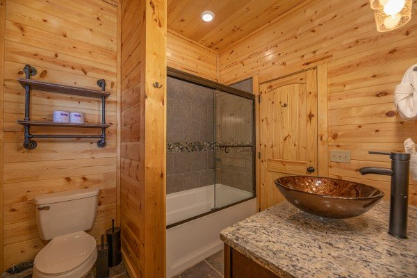 Bathroom with a tub and shower at Pinot Splash, a 4 bedroom cabin rental located in Gatlinburg