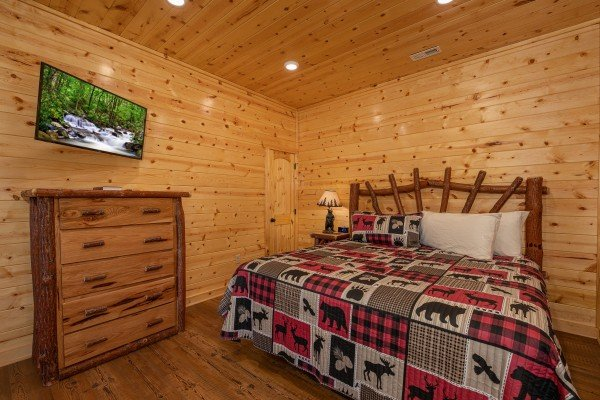 Bedroom with a king bed, dresser, and TV at Pinot Splash, a 4 bedroom cabin rental located in Gatlinburg