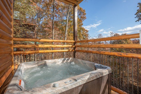 Hot tub on a deck at Pinot Splash, a 4 bedroom cabin rental located in Gatlinburg