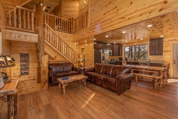 Living room with sofa and loveseat with adjacent dining space at Pinot Splash, a 4 bedroom cabin rental located in Gatlinburg