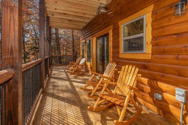 Deck with rocking chairs at Pinot Splash, a 4 bedroom cabin rental located in Gatlinburg