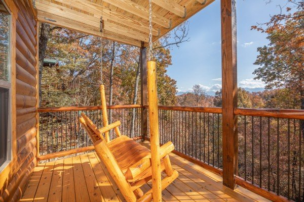 Porch swing on a covered deck at Pinot Splash, a 4 bedroom cabin rental located in Gatlinburg