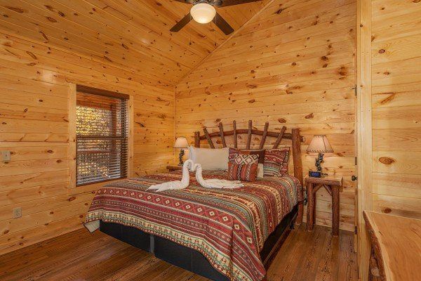 Bedroom with king bed, two night stands and lamps at Pinot Splash, a 4 bedroom cabin rental located in Gatlinburg