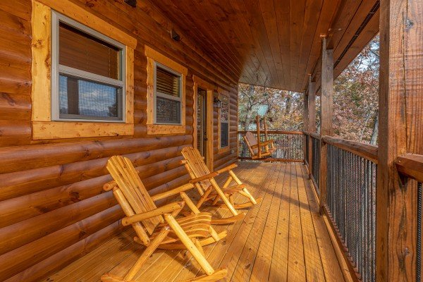 Rocking chairs on the covered upper deck at Pinot Splash, a 4 bedroom cabin rental located in Gatlinburg