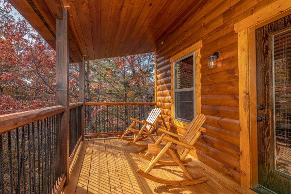 Rocking chairs on a covered deck at Pinot Splash, a 4 bedroom cabin rental located in Gatlinburg