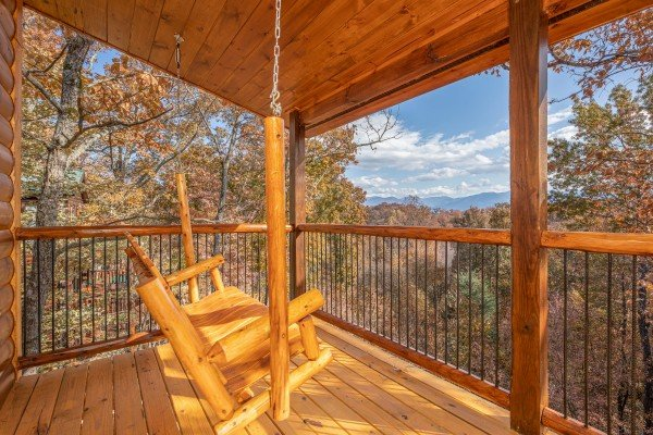 Swing on a covered porch at Pinot Splash, a 4 bedroom cabin rental located in Gatlinburg