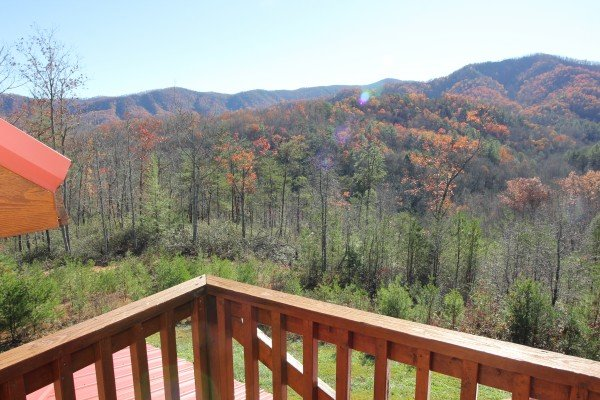 Fall colors as seen from the upper deck at Four Seasons Lodge, a 3-bedroom cabin rental located in Pigeon Forge