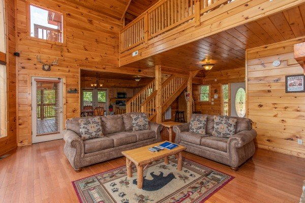 Sofa and loveseat in the living room at Four Seasons Lodge, a 3-bedroom cabin rental located in Pigeon Forge