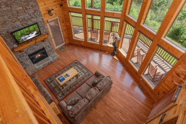 Looking down into the living room from the upper floor at Four Seasons Lodge, a 3-bedroom cabin rental located in Pigeon Forge