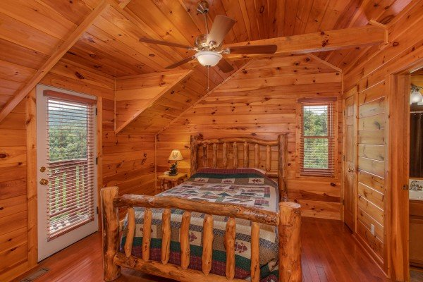 Queen bedroom on the upper floor with en suite bath at Four Seasons Lodge, a 3-bedroom cabin rental located in Pigeon Forge