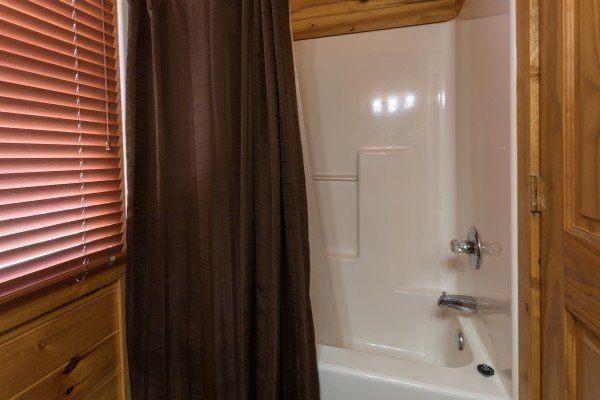 Upstairs bath with a tub and shower at Four Seasons Lodge, a 3-bedroom cabin rental located in Pigeon Forge