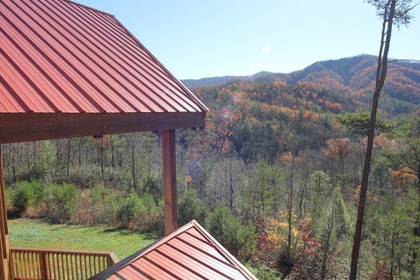 Fall colors seen from the upper deck at Four Seasons Lodge, a 3-bedroom cabin rental located in Pigeon Forge