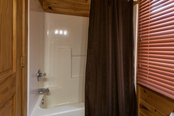 Bathroom with a tub and shower at Four Seasons Lodge, a 3-bedroom cabin rental located in Pigeon Forge