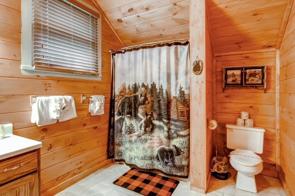 Loft bathroom with bear decor at Creekside Comfort, a 3-bedroom cabin rental located in Pigeon Forge